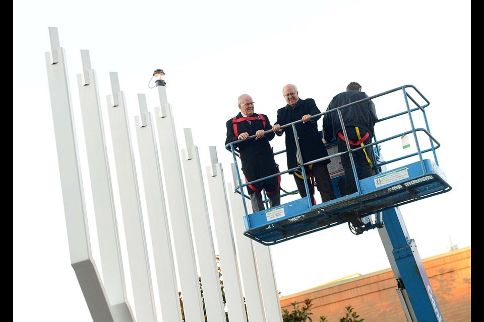 Mayor Malcolm Brodie was joined on the hoist by former Premier Bill Vander Zalm for the lighting of a giant 30-foot menorah to mark the start of Hanukkah outside Richmond Cultural Centre. Boaz Joseph photos