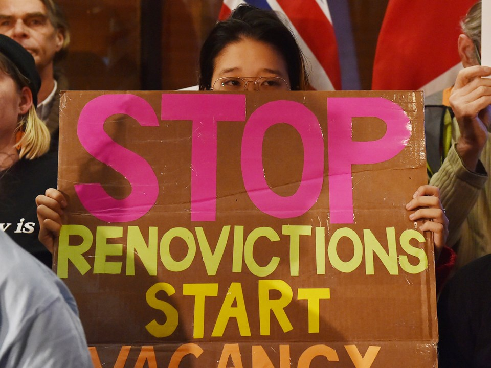 One of the signs at a renters' rally held before council voted on the renovictions motion. Photo Dan