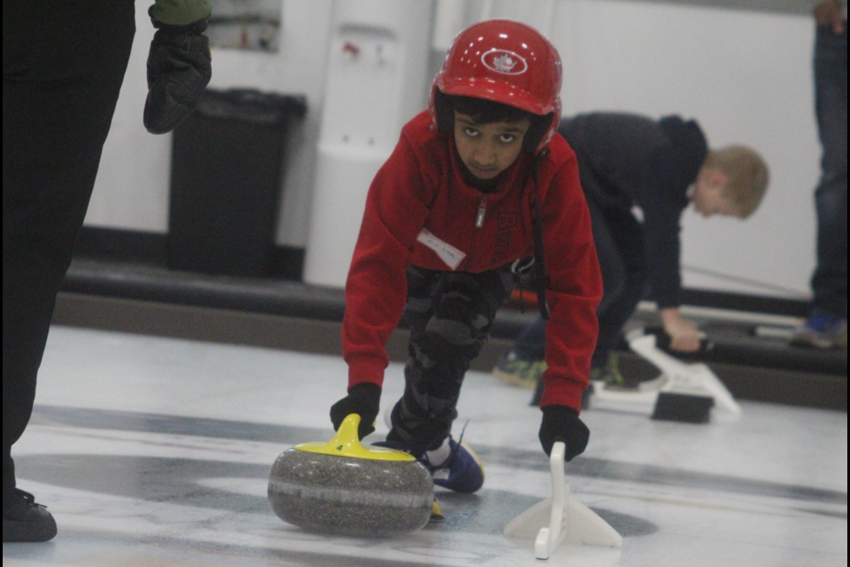 Arjun Parmar was one of several kids learning curling for the first time at the Dawson Creek Curling Club Saturday.