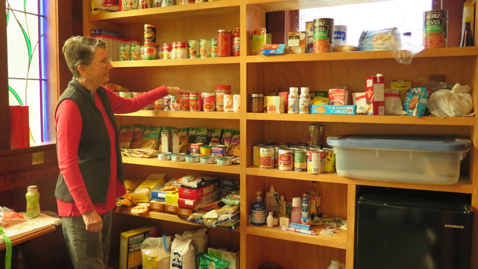 Cindy Leitner brings food and toiletries from Belterra Co-housing to the Bowen Island Food Bank