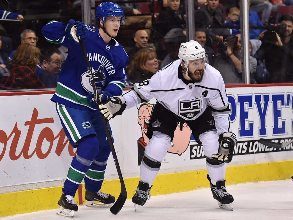 Elias Pettersson battles an incredulous Drew Doughty.