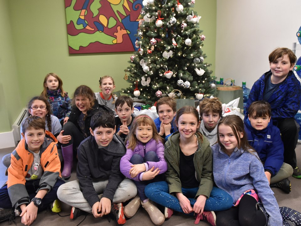 Lord Tennyson after-school program brings donations to the Courier for Directions Youth Services. Ph