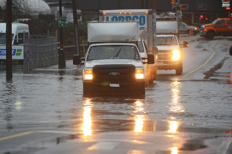 The intersection of Douglas Road and Still Creek Avenue has been flooded after heavy rainfall.