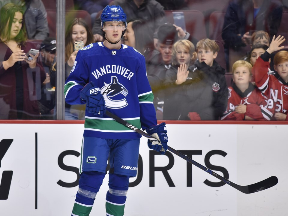 Elias Pettersson is admired by Canucks fans prior to a game.