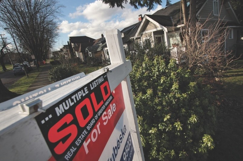 home sale sign winter vancouver real estate rob kruyt