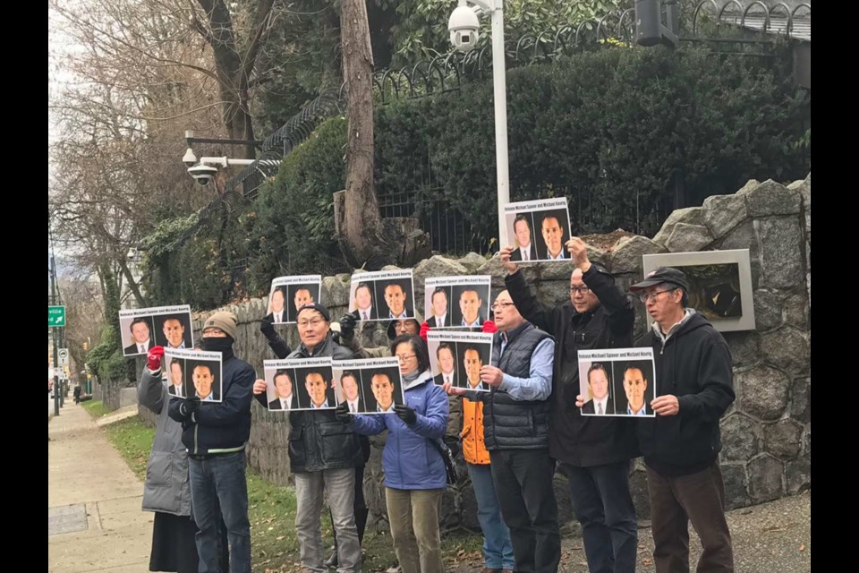 "Around 10 residents held pictures of the two Canadians and shouted ""Respect the Canadian legal system. Release Michael Kovrig. Release Michael Spavor"" in front of the Chinese consulate in Vancouver last Saturday. Photo submitted"