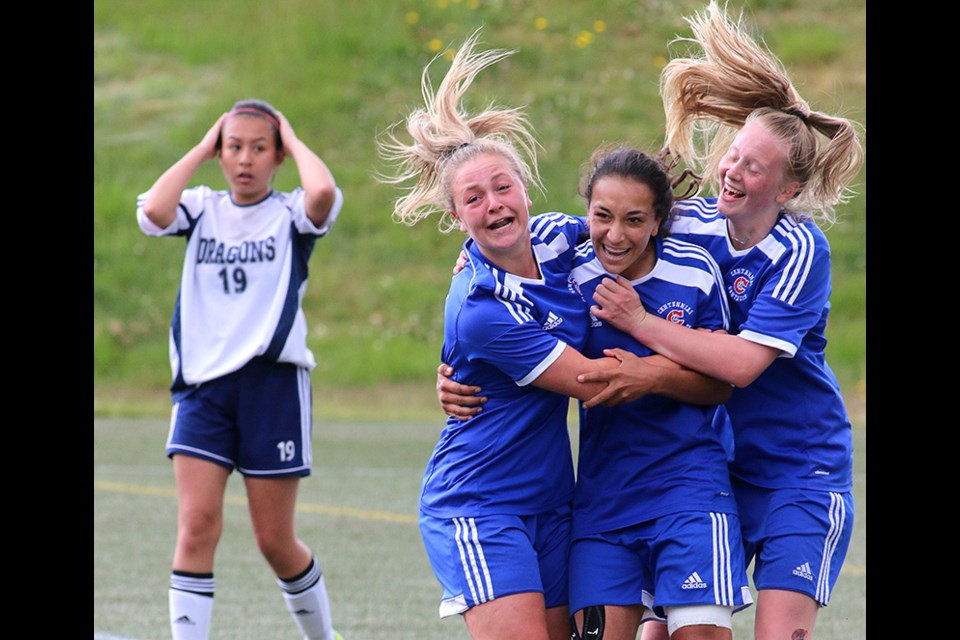 MARIO BARTEL/THE TRI-CITY NEWSCentennial Centaurs forward Sophia Ferreira, centre, is hugged by teammates Meghan Harder and Raegan Mackenzie, after she scored the winning goal in their 1-0 win over the Fleetwood Park Dragons in Friday's BC High School AAA senior girls soccer championship at the University of British Columbia's Thunderbird Stadium. Shooting sports is part luck, part intuition and part absorbed knowledge. Time was running out in the senior girls high school soccer championship that was scoreless late in the match so I moved from my usual shooting position along the end touch line to a spot on the sideline between the benches to better my chances of capturing any sort of reaction should a goal be scored. Then, it was.