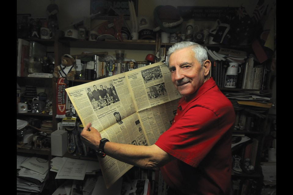 Sport historian Len Corben holds the North Shore Citizen newspaper which featured the first ever class inducted into the North Shore Sports Hall of Fame in 1968. The hall has been dormant since 1971 but Corben is leading a committee that will bring it back to life in 2019. photo Mike Wakefield, North Shore News
