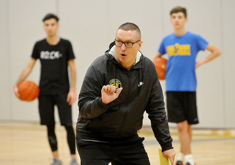 Gleneagle Talons senior boys basketball coach Jason Bingley conducts a recent practice.