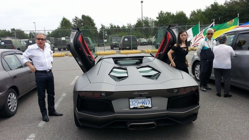 Richmond fraudster Paul Oei gets out of a Lamborghini with his wife, left, Loretta Lai, at the Sherm