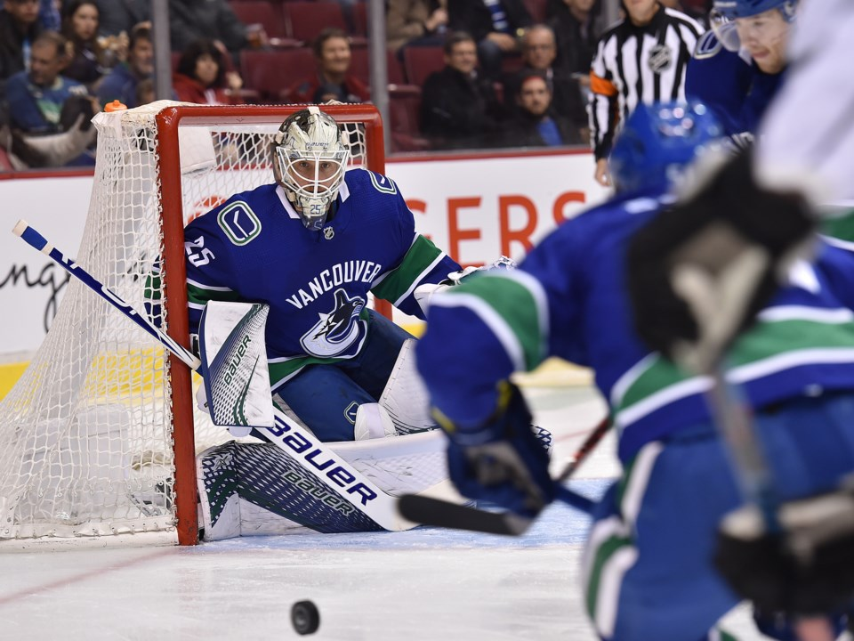 Jacob Markstrom stares down the puck in the Vancouver Canucks net.
