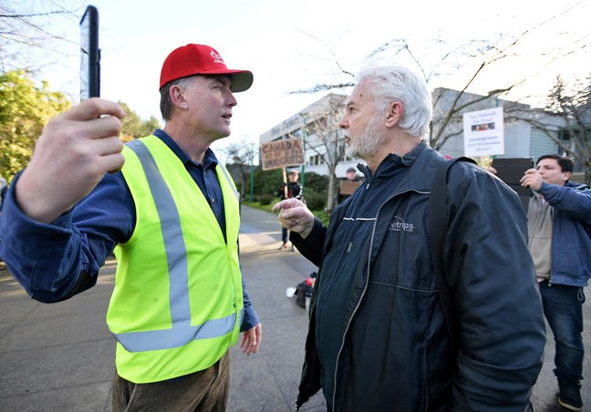 National Citizens Alliance founder Stephen J Garvey faces off with Burnaby's Alan Dutton, who leads the Canadian Anti-Racism Education and Research Society, on Saturday at Burnaby city hall. Photo: Jennifer Gauthier