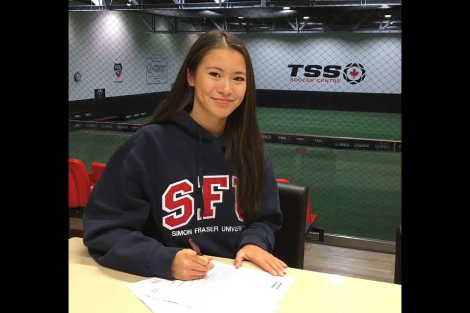 Cariboo Hill's Amanda Scott signs her letter of intent to play and study at Simon Fraser University.