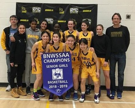 The Burnaby South Rebels celebrate their league playoff victory Tuesday, edging Burnaby Central 58-57 on a last-second shot.