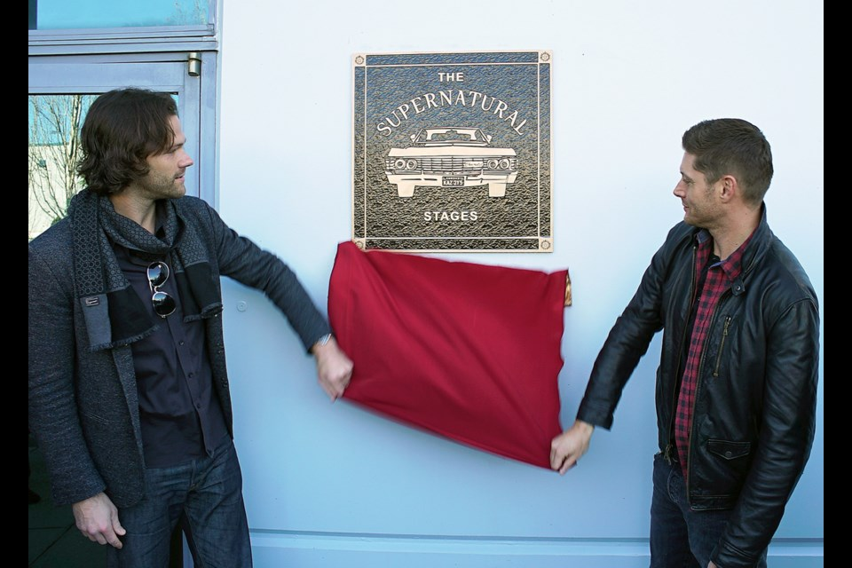 Supernatural stars Jared Padalecki, left, and Jensen Ackles unveil a plaque commissioned by Canadian Motion Picture Park president Alec Fatalevich to commemorate the show's 300th episode, which aired Feb. 7. The Warner Bros.' TV series has been filming at the Burnaby studio since it premiered in 2005. The plaque hangs at the main entrance to the studio.