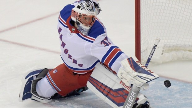 Marek Mazanec makes a save for the New York Rangers.