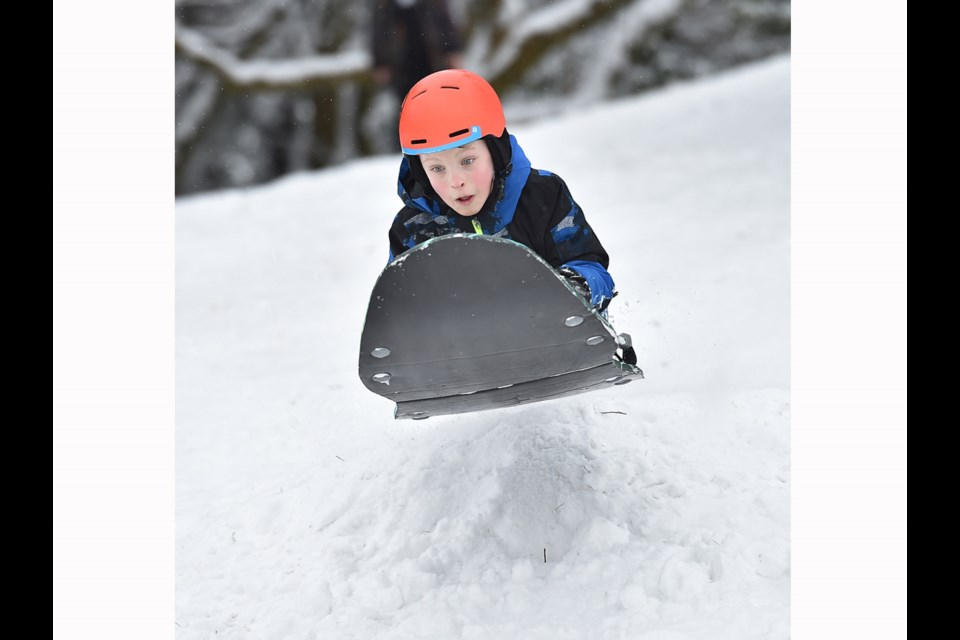 Nine year old Cameron McRae takes a jump on his sled at Queen Elizabeth park Tuesday morning. Photo Dan Toulgoet