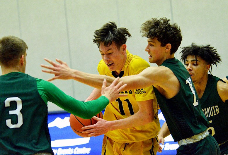 Burnaby South's Aidan Wilson, at centre, shown during the season-opening Tsumura Invitational, will be one of the team's big pieces as it heads into the 4-A Lower Mainland senior boys basketball tournament next week.