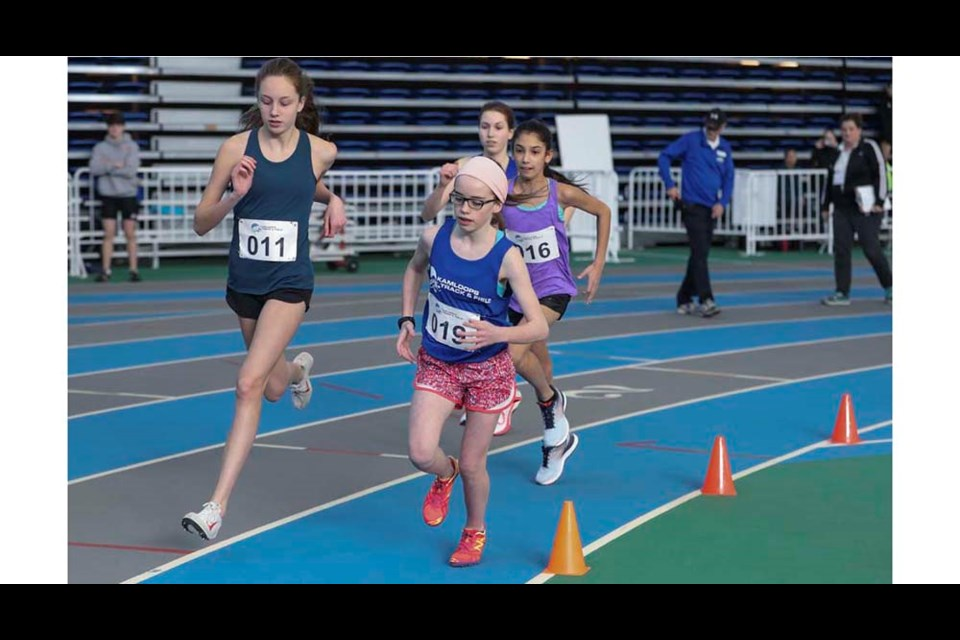 Sophia D'Amore (left) and Danica Renwick of the Kamloops Track and Field Club lead the pack in a race at the Gary Reed Invitational track and field meet last weekend at the TCC. Raiya Matonovich and Kayla Hermiston are chasing. Find more photos online at kamloopsthisweek.com.