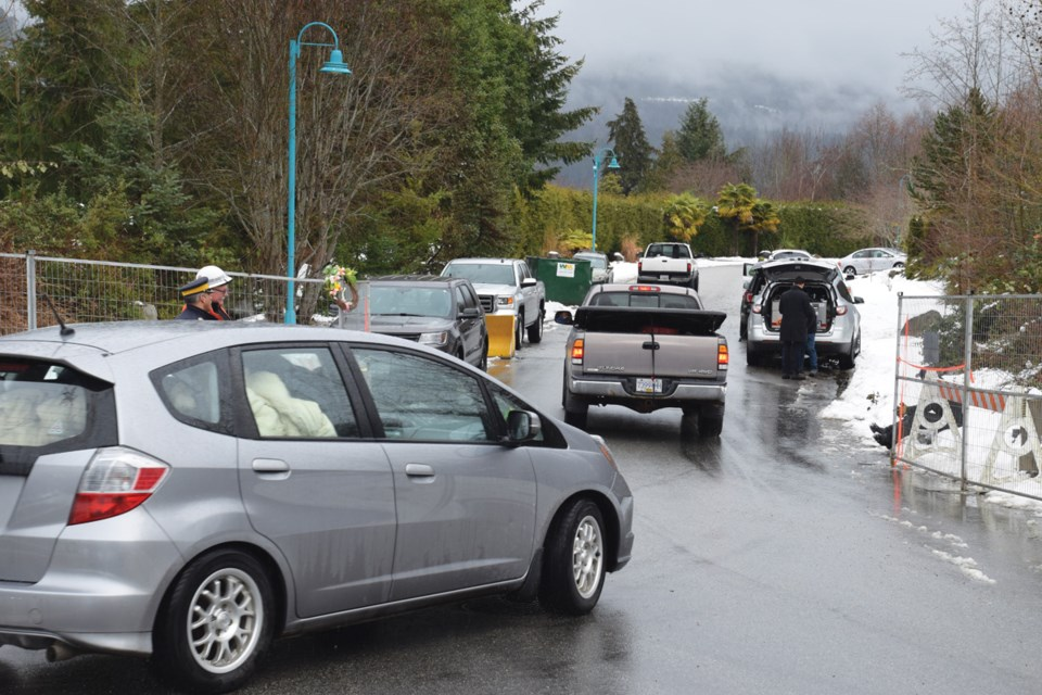 The few remaining residents leave Seawatch on Friday, Feb. 15 as District of Sechelt crews get ready to close and lock a security fence behind them.