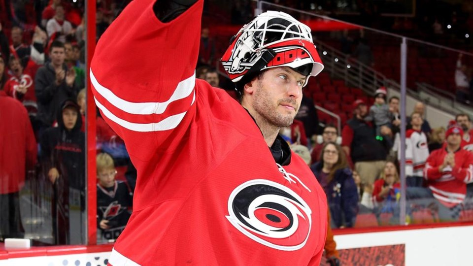 Michael Leighton waves to the crowd while with the Carolina Hurricanes.