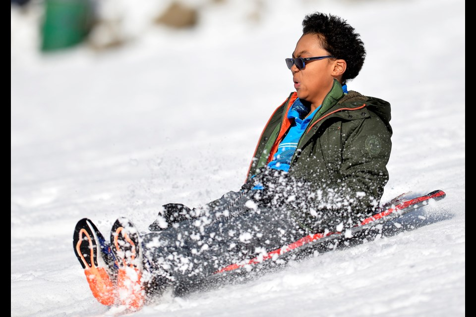 12-year-old Jako Plummer sleds on Burnaby Mountain.