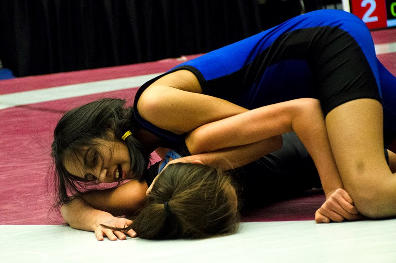 Burnaby Central's Tanisha Johal (blue) gains the upperhand on Lillooet's Lakiesha Jacob in the girls' 40-kg division final at the BCSSWA provincial championships at Langley Events Centre.