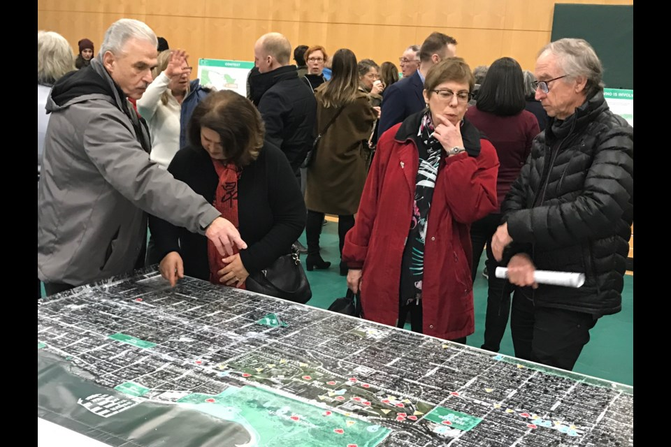 Jericho Lands open house attendees examine a map of the site. Photo Naoibh O'Connor