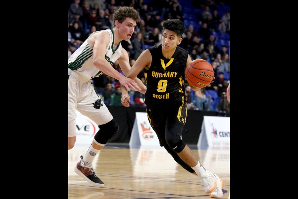 Burnaby South's Baltej Sohal goes on the attack during Friday's semifinal game against Lord Tweedsmuir at the B.C. 4-A senior boys basketball championships at the Langley Events Centre.