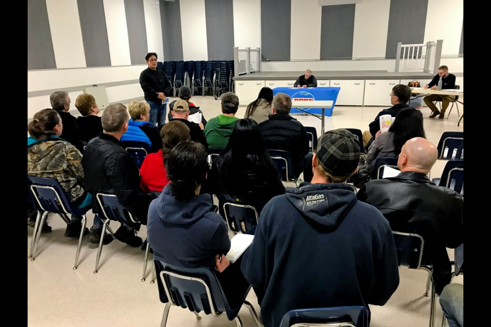 Garry Oker, president of the Tse'K'wa Heritage Society, speaks to a public hearing audience in Charlie Lake on March 18, 2019.