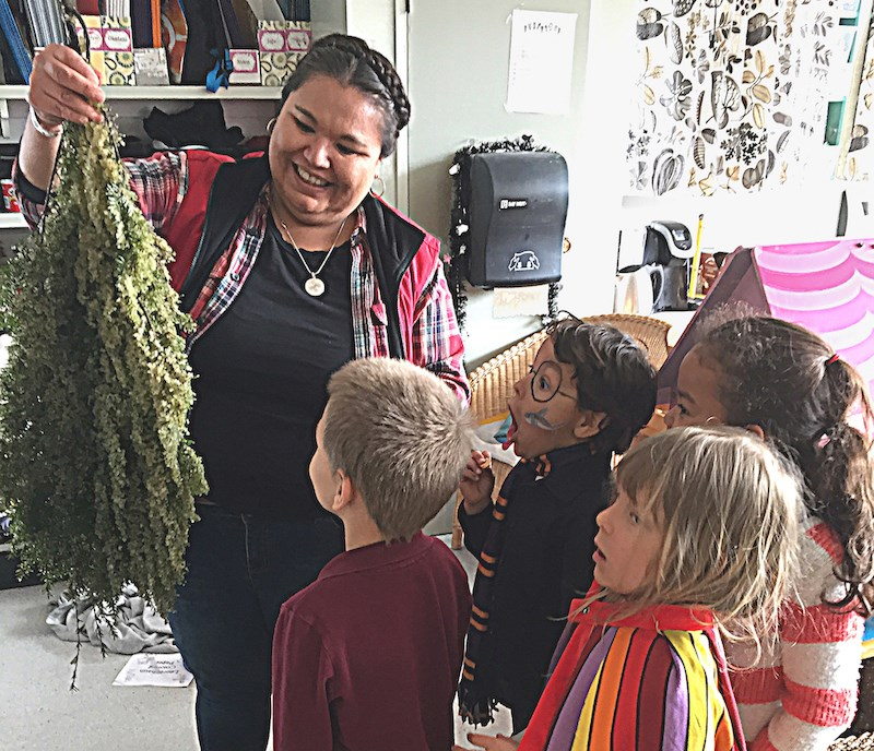 Students admire a hemlock bough covered in herring roe.