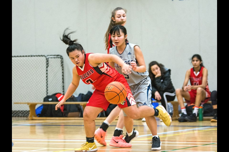 Burnaby Central's Jalynne Huynh, at left, holds off a defender during a game earlier this year. The Grade 12 guard was one of a select few chosen to play in Thursday's Senior Girls All-Star game at Riverside Secondary in PoCo.