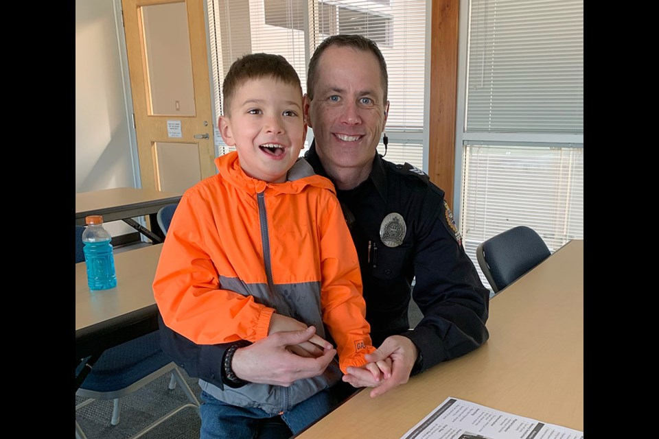 Port Moody police officer Rob DeGoey with his son, Keyen, who's on the autism spectrum.