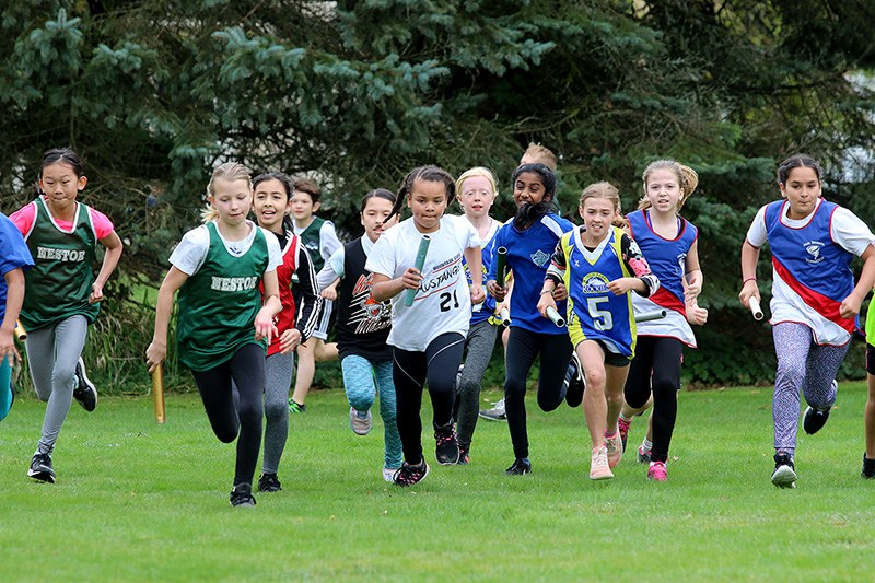 MARIO BARTEL/THE TRI-CITY NEWS And they're off, in the girls Grade 4 race at last Wednesday's opening day of the Como Lake Relays.