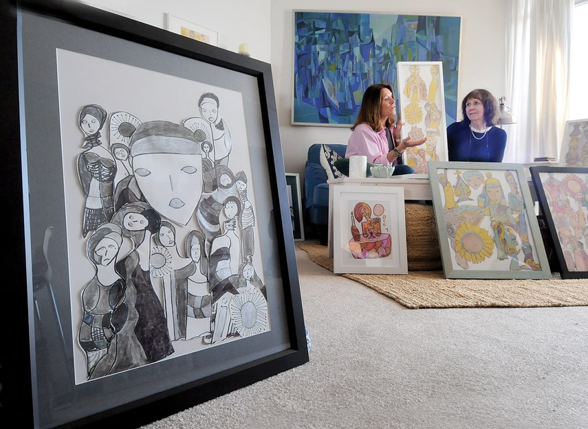 Sisters Shelley Adams and Clare Hetherington sit surrounded by some of their mother Bernice Hetherington's artwork which is on its way to the Vancouver Convention Centre for Art Vancouver April 25-28.