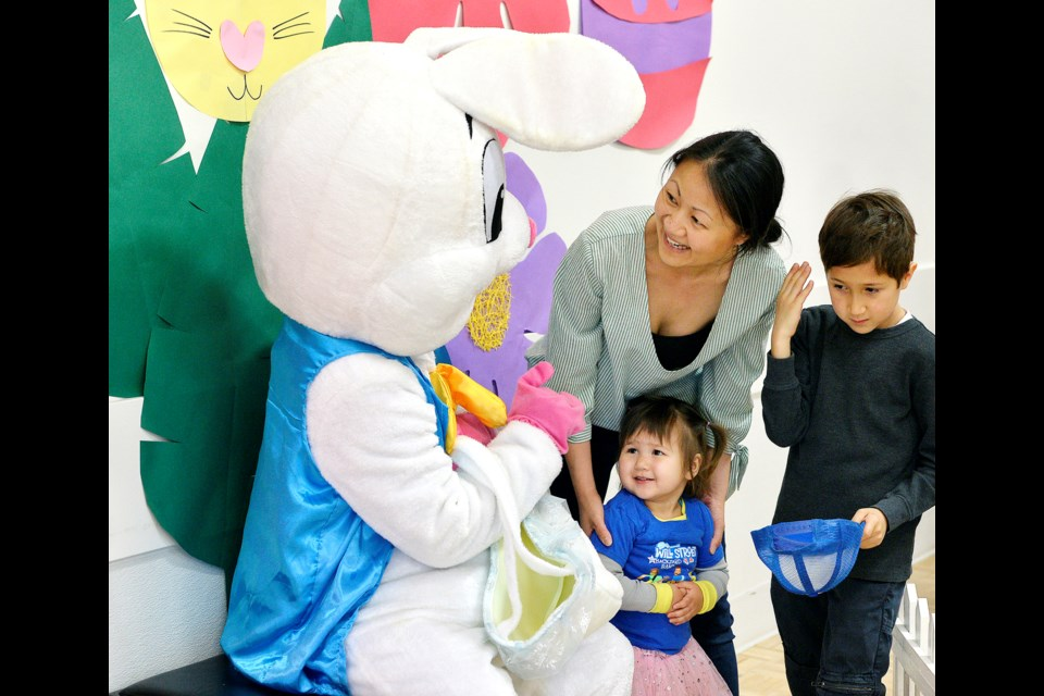 Jacob, 7, and Abigail Smith, 2, meet the Easter Bunny.
