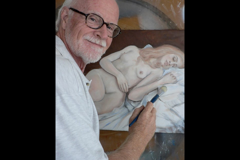 Tom Morgan at work. An exhibition of Morgan's paintings is on display at Plaskett Gallery for the month of May.