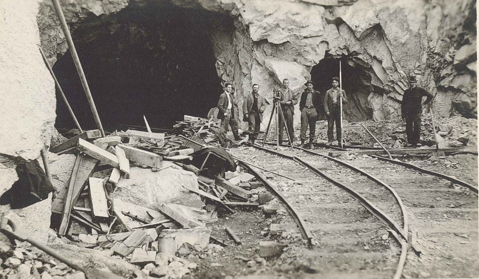 Workers at the end of the Buntzen tunnel.