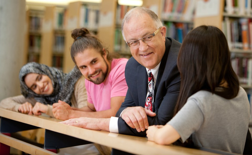 Vancouver Island University president Ralph Nilson chats with students. Photo Vancouver Island Unive