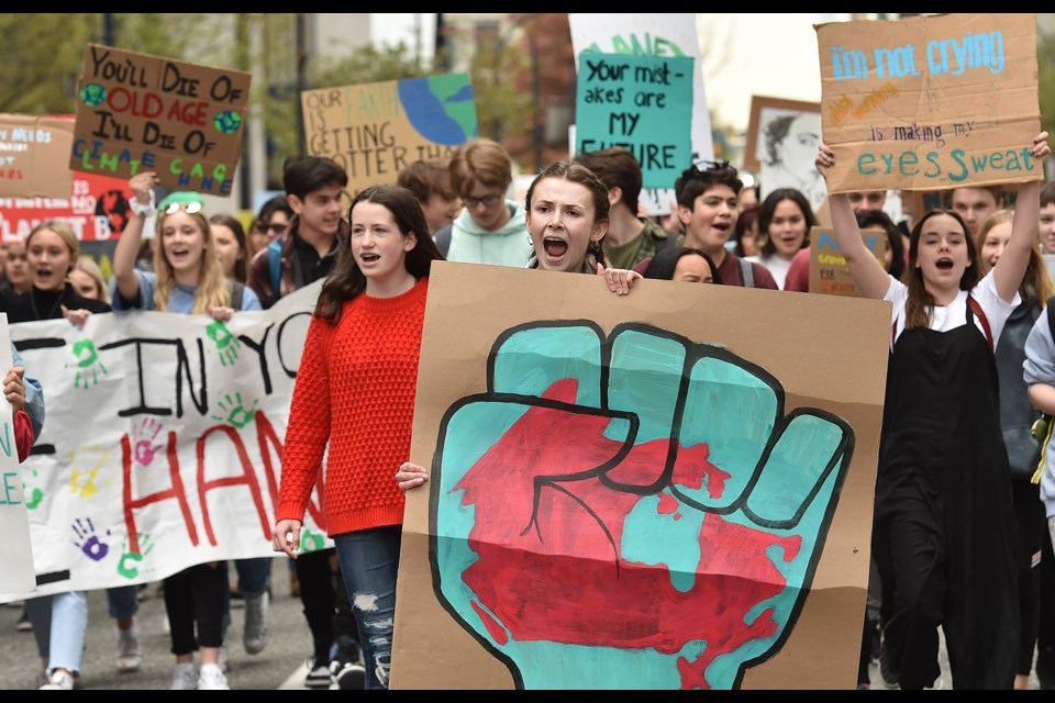 Hundreds of students from across the Lower Mainland took to the streets of downtown Vancouver Friday, marching for action on climate change as part of the Climate Strike movement. Photo Dan Toulgoet