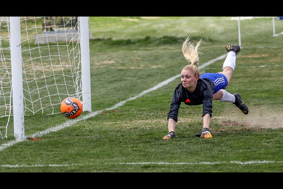 Ellie Parker makes a diving stop at the Mike Bartram Memorial Youth Soccer Tournament in Kamloops on the weekend.