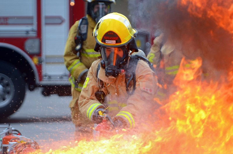 Byrne Creek Grade 12 student Nathan Ly battles a blaze during the Burnaby Fire Department's youth academy last Thursday.