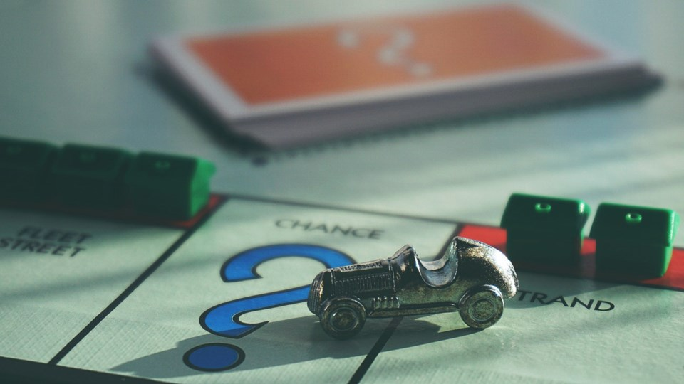 Monopoly game houses car chance game question