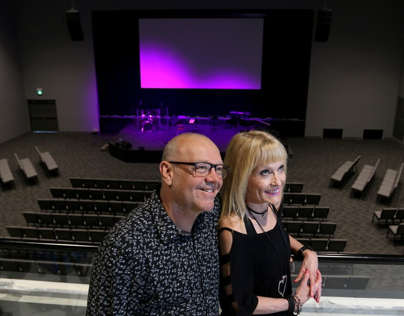 Co-pastors at Riverside Church, Terry and Ingrid Janzen, take in the view from the balcony above the church's main theatre that can hold more than 2,000 worshipers.