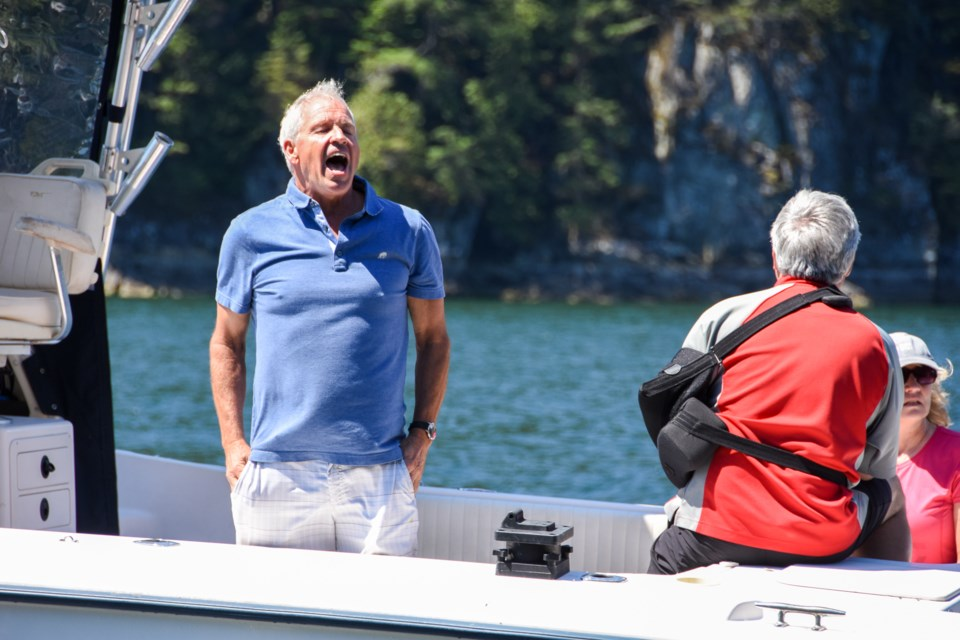 A boater's reaction after MacVicar warns him that he got too close to the transient orca family