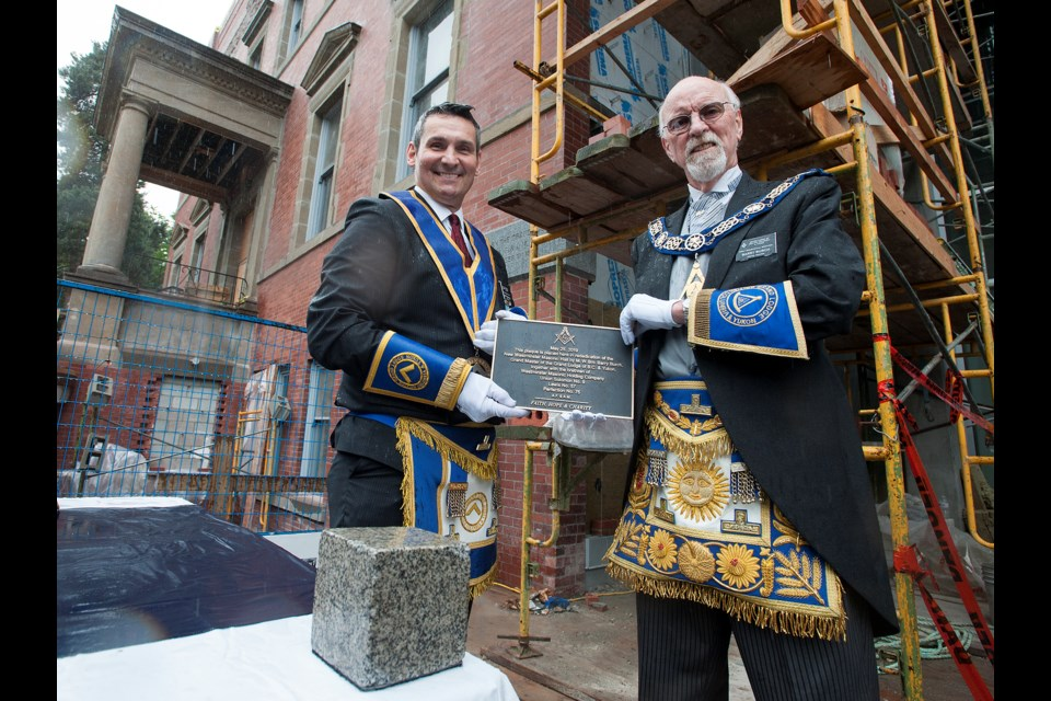 Grand Master Barry Burch and District Deputee Grand Master Scott Marshall were among the local freemasons and representatives from the Grand Lodge of British Columbia and Yukon who gathered to rededicate a cornerstone on the freemason hall at 508 Agnes St. in 1912 on Saturday. The plaque was removed from the building when redevelopment of the site got underway.