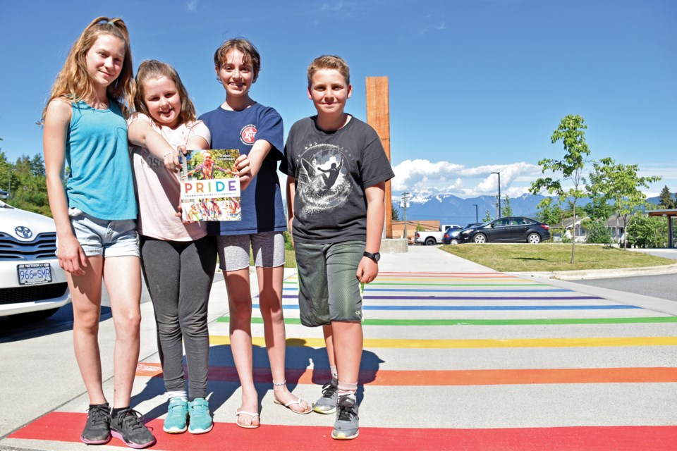 Jessica, Madeline, Maya and Johnathan, students in Colleen Hourigan's Grade 5/6 class, organized the painting of a rainbow crosswalk at Gibsons Elementary School after author Robin Stevenson presented her book, Pride.