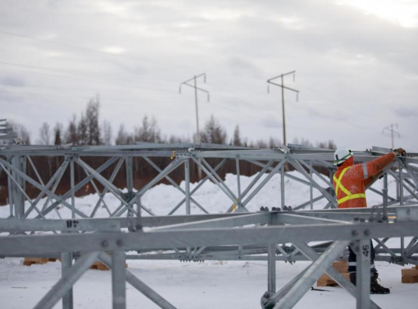 A worker assembles one of 405 towers that will hold up two 75-kilometre, 500-kv transmission lines. The lines will connect power from Site C to BC Hydro's transmission system through the Peace Canyon switchyard.