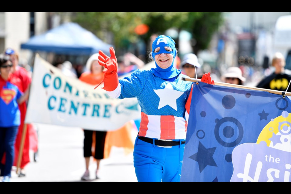 Parade participants embraced the superhero theme in style.