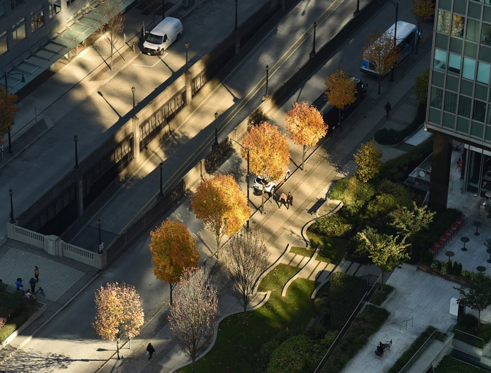 A view with afternoon sunlight shining between downtown buildings. Photo Dan Toulgoet